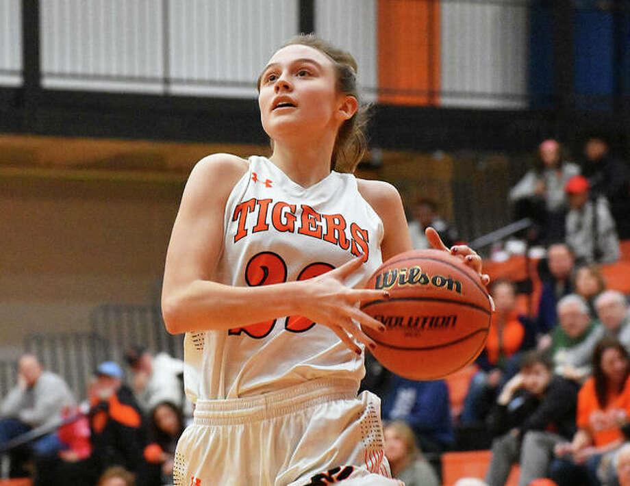 Edwardsville senior guard Megan Silvey drives to the basket in the second quarter against Granite City on Thursday in Edwardsville. Photo: Matt Kamp/Intelligencer