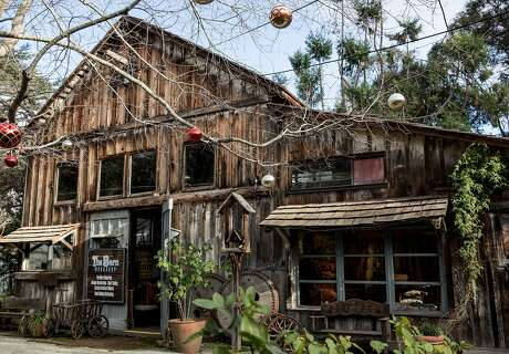 The Barn Woodshop is, indeed, a barn that houses the Barn Woodshop, a woodworking studio that Tom Kieninger's family has run for decades. It is part of the Allied Arts Guild complex in Menlo Park. Photo: Jessica Christian / The Chronicle