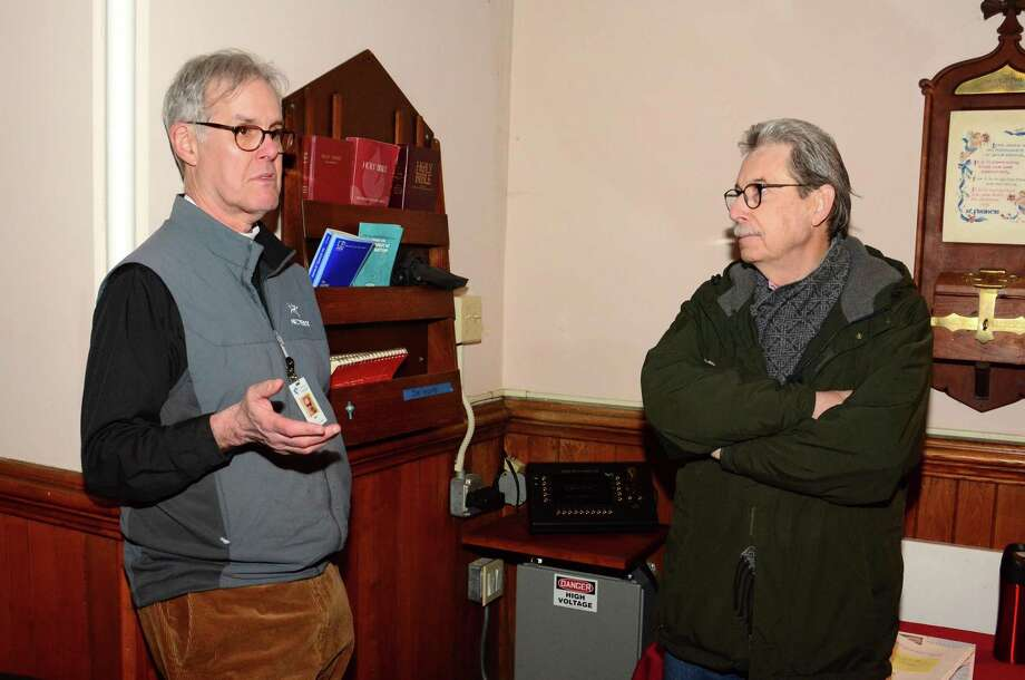 Jack Gilpin, Rector of St. Johns Episcopal church in New Milford, left, and Herb St. Jean, from Danbury at the church on Thursday December 20, 2018. . St. Jean led the effort to refurbish the bell that will ri.ng for the first time in years at the church on Christmas. Photo: Lisa Weir / For Hearst Connecticut Media / The News-Times Freelance