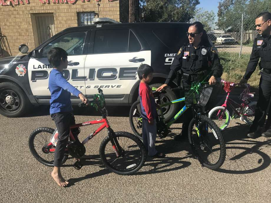 Laredo police officers surprised a local family down on their luck with Christmas gifts. Photo: Courtesy Laredo Police Department