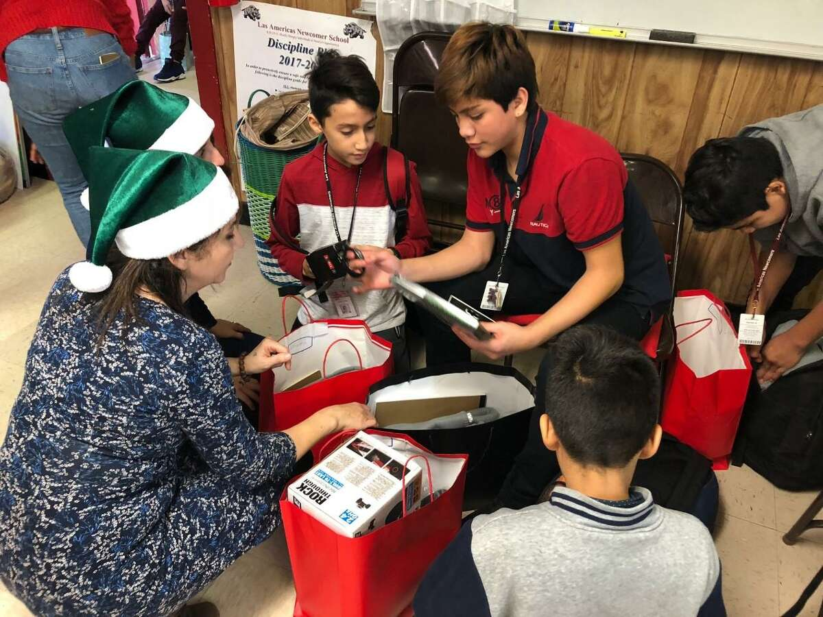 A Christmas celebration honoring more than 50 at-risk Las Americas Newcomer school students and their teachers was held Dec. 19, 2018, at Las Americas Newcomer School, 6501 Bellaire Blvd. in Houston in front of Houston ISD and French Consulate representatives.
