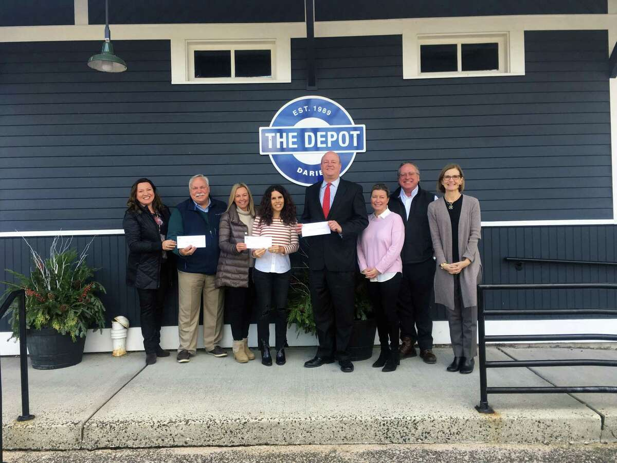 The Darien Chamber of Commerce recently awarded The Depot, Star Inc., and the Darien Chamber Charitable Foundation donations from the annual Wine and Food Tasting. From left, Teresa Jandziol, business manager, Darien Chamber of Commerce; Peter Saverine, director of Philanthropy, Star Inc.; Melissa Cutler, Fundraising co-chairwoman, The Depot; Gina Vivenzio, Fundraising co-chair, The Depot; Mark Rosenbloom, chairman, Darien Chamber Charitable Foundation; Cheryl Williams, event co-chair, Darien Chamber of Commerce; Al Tibbetts, event co-chair, Darien Chamber of Commerce; and Susan Cator, president, executive director, Darien Chamber of Commerce.