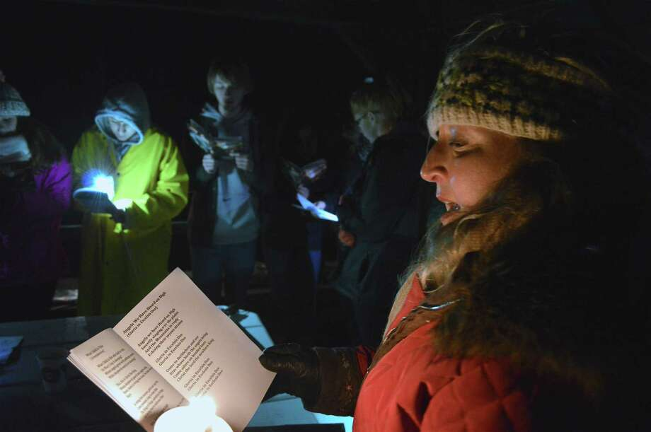 Lucia Zachowski, Friends of Gorham's Pond president, leads the singing at the 2nd annual Town-Wide Caroling Sing Along, sponsored by Friends of Gorham's Pond, at Pear Tree Beach on Sunday in Darien. Photo: Jarret Liotta / For Hearst Connecticut Media / Darien News Freelance
