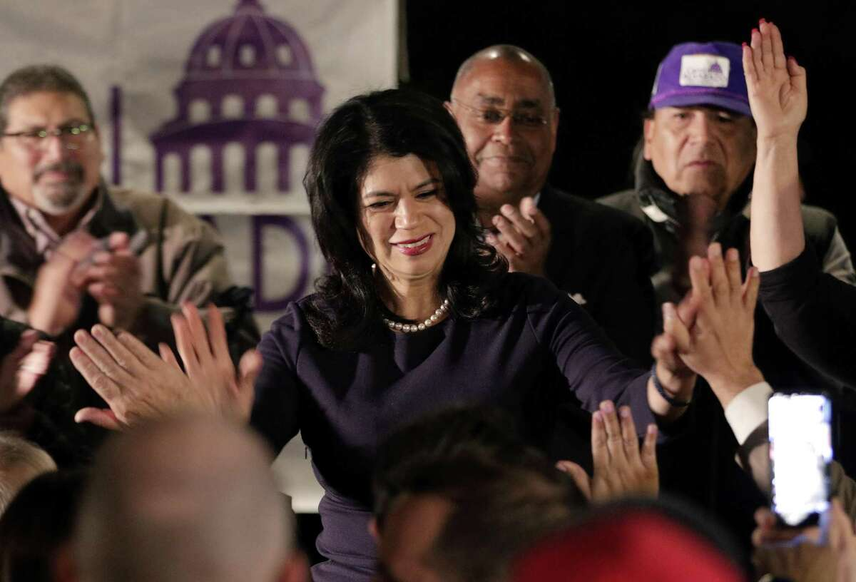 Carol Alvarado high fives attendants from the stage as she gives remarks at her watch party held at Raven Tower Tuesday, Dec. 11, 2018 in Houston, TX. >>See the firsts from this year's midterm elections in the photos that follow...