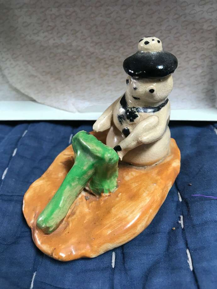 Snowman was sculpted by a boy with a broken leg 60 years ago. Photo: Contributed Photo /