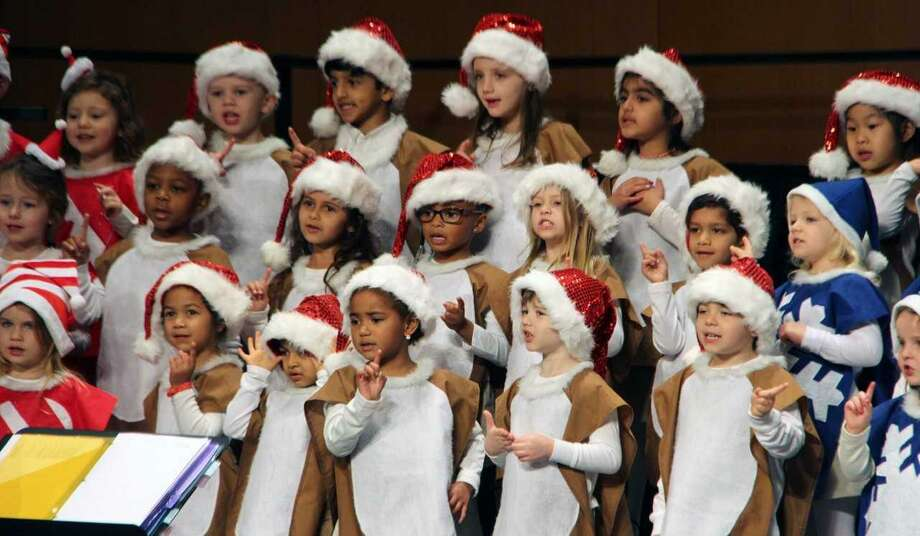 The John Cooper School students in Pre-K, kindergarten, first and second grade performed a holiday concert on campus before leaving for winter break. Their songs were accompanied by drums and choreography. Photo: Courtesy Photo / Courtesy Photo