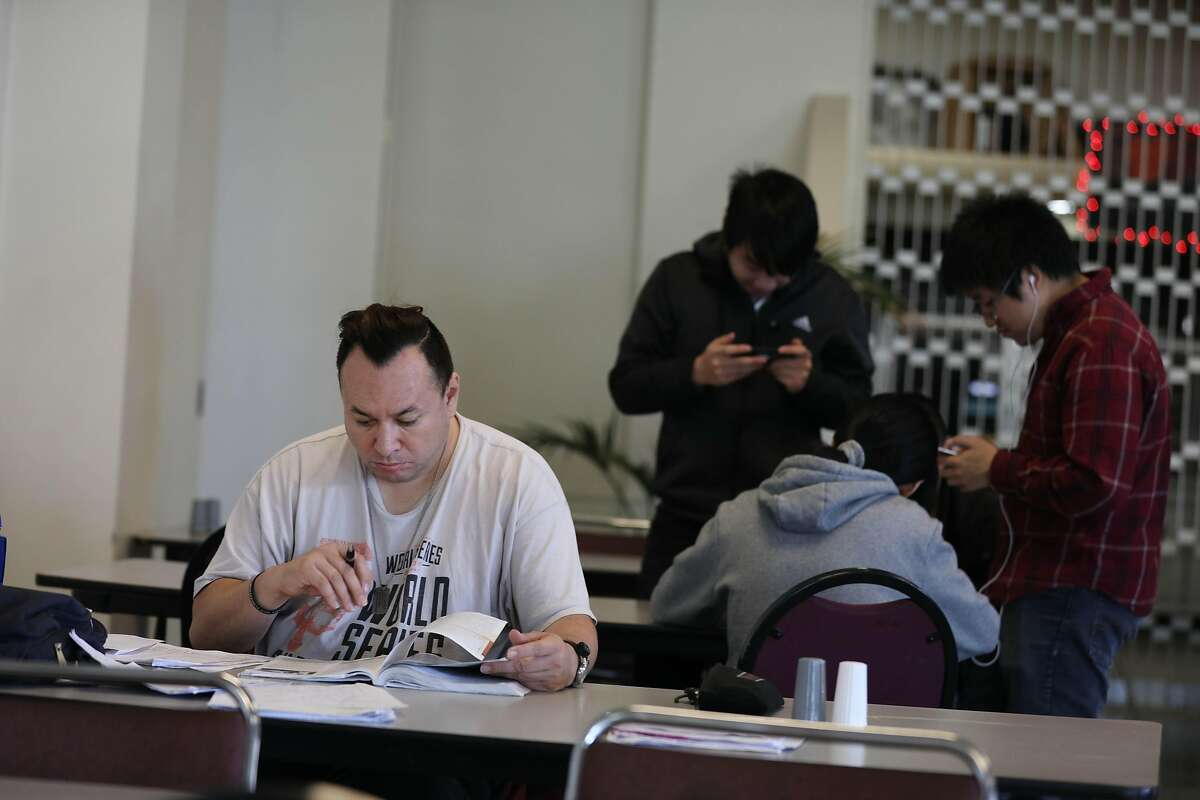 City College student Scott Cruse studies for his final in Smith Hall on Tuesday, December 18, 2018 in San Francisco, Calif.