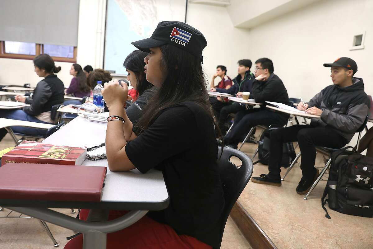 """City College of SF student, an Asian American studies major and community organizer Win-Mon Aung Kyi (middle) attends her Cultural Geography class at CCSF on Friday, Nov. 30, 2018, in San Francisco, Calif. She has been active in trying to get the """"Free City"""" program (no tuition for SF residents) extended for 10 more years."""