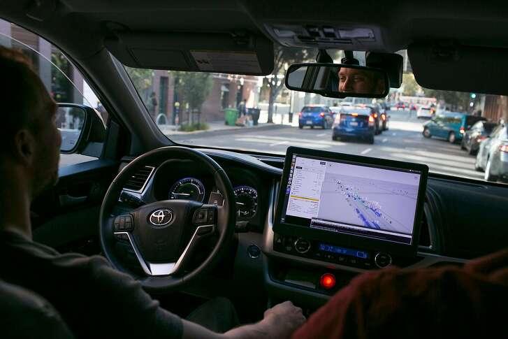 Janek Hudecek a Zoox employee sits behind the wheel of an autonomous Zoox car as it self drives down a street on Friday, Sept. 7, 2018 in San Francisco, Calif.