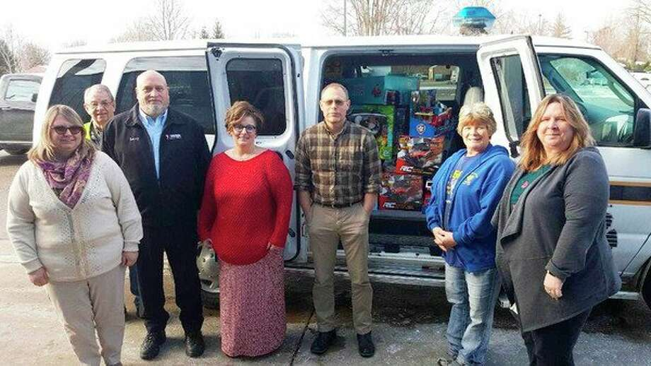 The employees at Tower Automotive collected enough Toys for Tots this yearto fillup an entire Huron County Sheriff's Office van. (Courtesy Photo)