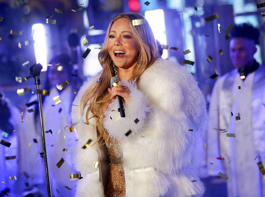 "FILE - In this Dec. 31, 2017 file photo, Mariah Carey performs at the New Year's Eve celebration in Times Square in New York. A poll shows more Americans are favoring Christmas carols over recent Billboard hits, while longtime classics and recent comedies are the most preferred to watch during the holiday season. A poll by The Associated Press-NORC Center for Public Affairs Research shows ""Silent Night"" as the country's most popular, despite Mariah Carey's ""All I Want for Christmas Is You"" becoming the highest-charting Billboard Hot 100 holiday hit in 60 years. (Photo by Brent N. Clarke/Invision/AP, File) Photo: Brent N. Clarke, Associated Press"