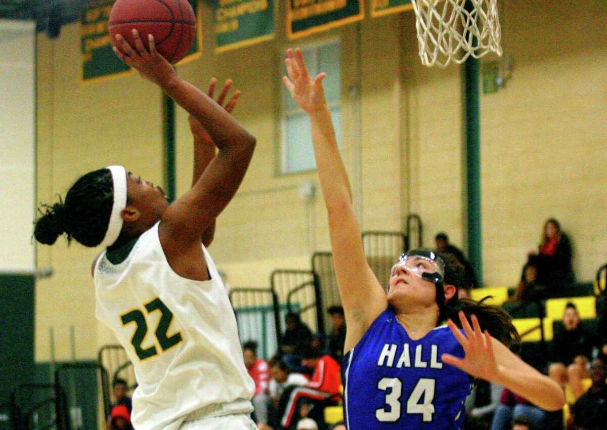 Hamden's Taniyah Thompson (22) looks to score as Hall's Olivia Bonee (34) defends during basketball action in Hamden on Dec. 18. Thompson scored 36 points against Hall this week.