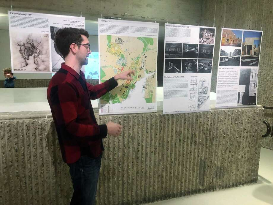 "Jonathan Hopkins describes his exhibit for members of The New Haven Preservation Trust. The exhibit ""Redevelopment: The Story of Church Street South,"" at YalesSchool of Architecture, will be open weekdays from 9-5 until Jan 3. Photo: Duo Dickinson /"