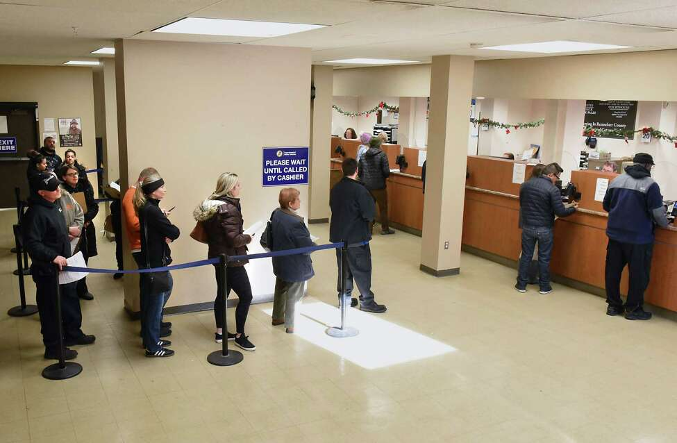 People wait in line at the Department of Motor Vehicles on Thursday, Dec. 20, 2018 in Troy, N.Y. The state Association of County Clerks will push this coming year for the state reimbursement on DMV services to be upped from 12.7 percent to 25 percent. (Lori Van Buren/Times Union)