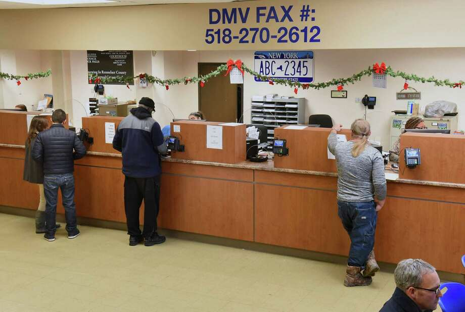 Cashiers help customers at the Department of Motor Vehicles on Thursday, Dec. 20, 2018 in Troy, N.Y. The state Association of County Clerks will push this coming year for the state reimbursement on DMV services to be upped from 12.7 percent to 25 percent. (Lori Van Buren/Times Union) Photo: Lori Van Buren, Albany Times Union / 20045760A
