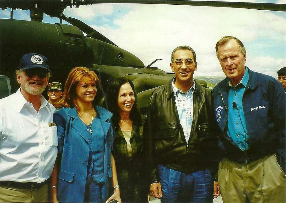 Amb. James Creagan is far left. Then-Honduran President Carlos Roberto Flores is standing next to President George H.W. Bush during a 1998 visit to see devastating hurricane damage. Photo: /