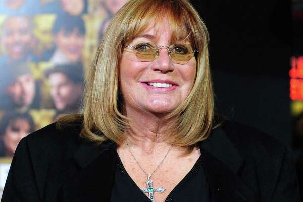 """Actor/director/producer Penny Marshall poses on arrival for the film premiere of """"New Year's Eve"""" at Grauman's Chinese Theater in Hollywood in 2011. She died Monday."""