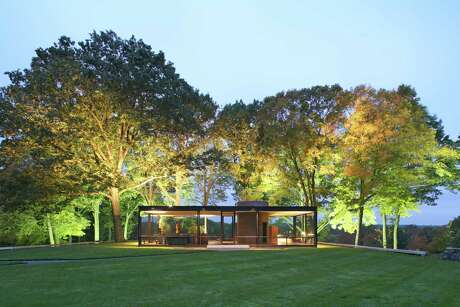 "The Glass House in New Canaan, Conn., which Johnson designed and built for himself in the late 1940s, early in his architecture career, is considered the work that most defines him, ""a modernist's plantonic ideal of a home,"" according to Mark Lamster's new book ""The Man in the Glass House."""