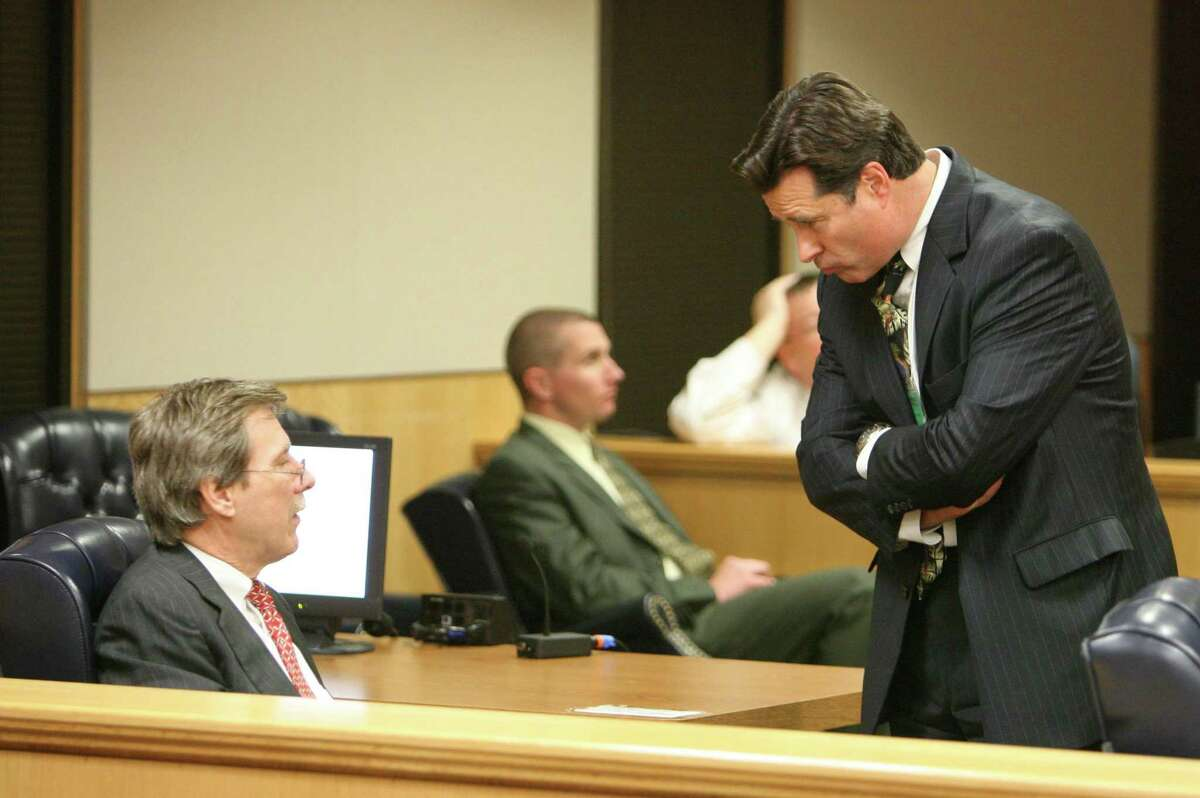 Fort Bend County District Attorney John Healey, right, speaks with Randy McDonald, defense attorney for Bart Whitaker, as they wait for the jury to return with a sentence in 2007. Whitaker was convicted of the 2003 murder-for-hire killing of his mother and brother and was scheduled to be executed this past February, but had his sentence commuted to life in prison by Gov. Greg Abbott.