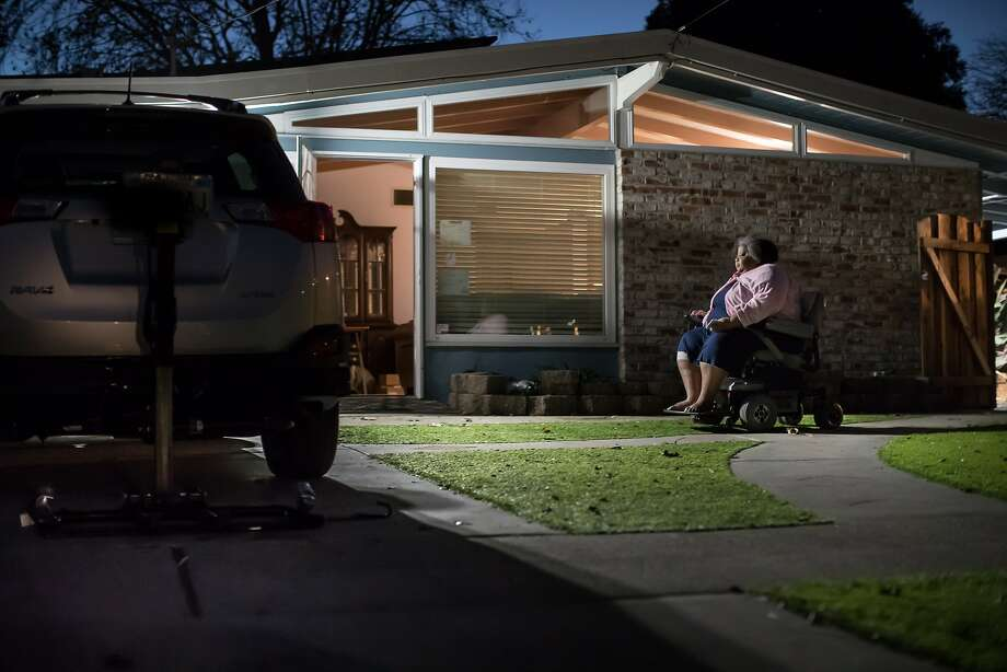 Johnson, 62, who uses an electric wheelchair, heads into the house in Hayward where she has lived since she was 4. Season of Sharing helped her keep her home. Photo: Paul Kuroda / Special To The Chronicle