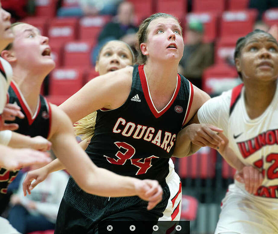 SIUE's Sydney Bauman, center, scored eight points and grabbed 10 rebounds in the Cougars' 68-65 loss to Missouri State University Friday in Kansas City. She is shown in action against Illinois State Earlier this season. Photo: SIUE Athletics