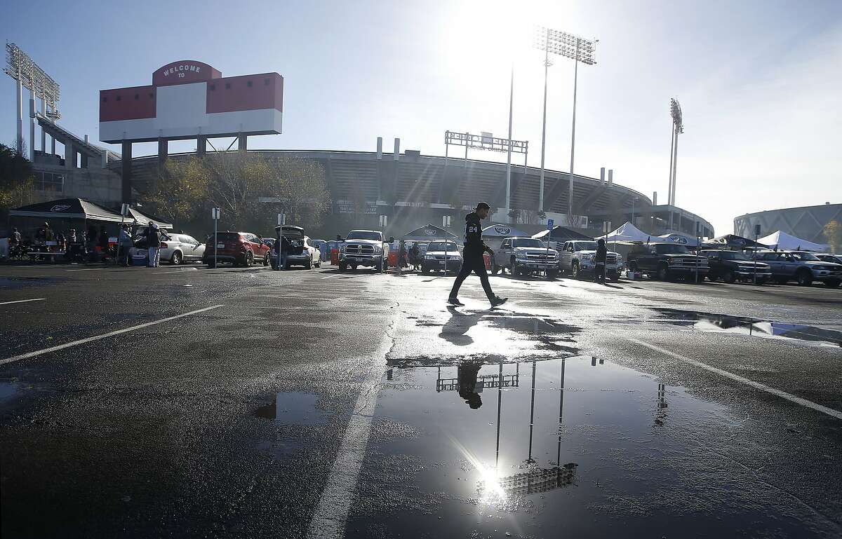 Fans tailgate outside of Oakland Alameda County Coliseum before an NFL football game between the Oakland Raiders and the Carolina Panthers in Oakland, Calif., Sunday, Nov. 27, 2016. (AP Photo/Tony Avelar)