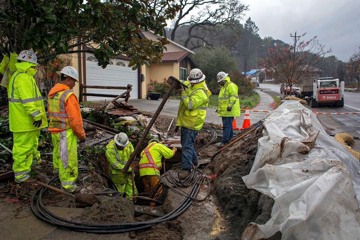 PG&E subcontractors with Alvah Contractors dig out trenches to replace underground power lines that were damaged in the Tubbs Fire, Friday Dec. 13, 2018, in Santa Rosa, Ca.