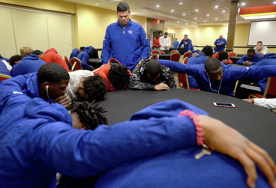 West Brook head coach Eric Peevey leads his team in prayer as they gather at their hotel for dinner after arriving in Arlington Friday night for  their state final Class 6A Div. II game Saturday at AT&T Stadium. The team and coaches then headed to the stadium to watch Aledo take on Fort Bend Marshall in the Class 5A Div. II championship and also familiarize themselves with what to expect when they take the field tomorrow against Longview. Photo taken Friday, December 21, 2018 Kim Brent/The Enterprise Photo: Kim Brent/The Enterprise