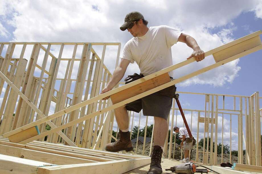 The construction industry continues to add jobs as the Houston and Texas economies continue to grow. Photo: Seth Perlman, STF / AP / AP