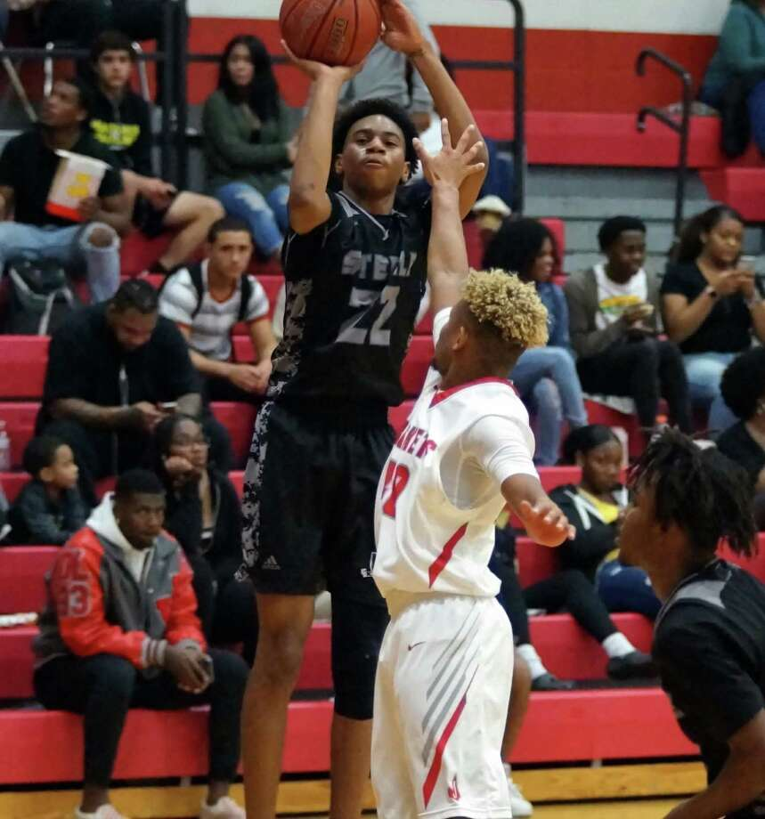 Steele's Kwabena Davis launches a shot over a Judson defender during the Knights' 76-68 road win over Judson on Dec. 18. Davis scored nine points. Photo: Lavon Brown / Contributor