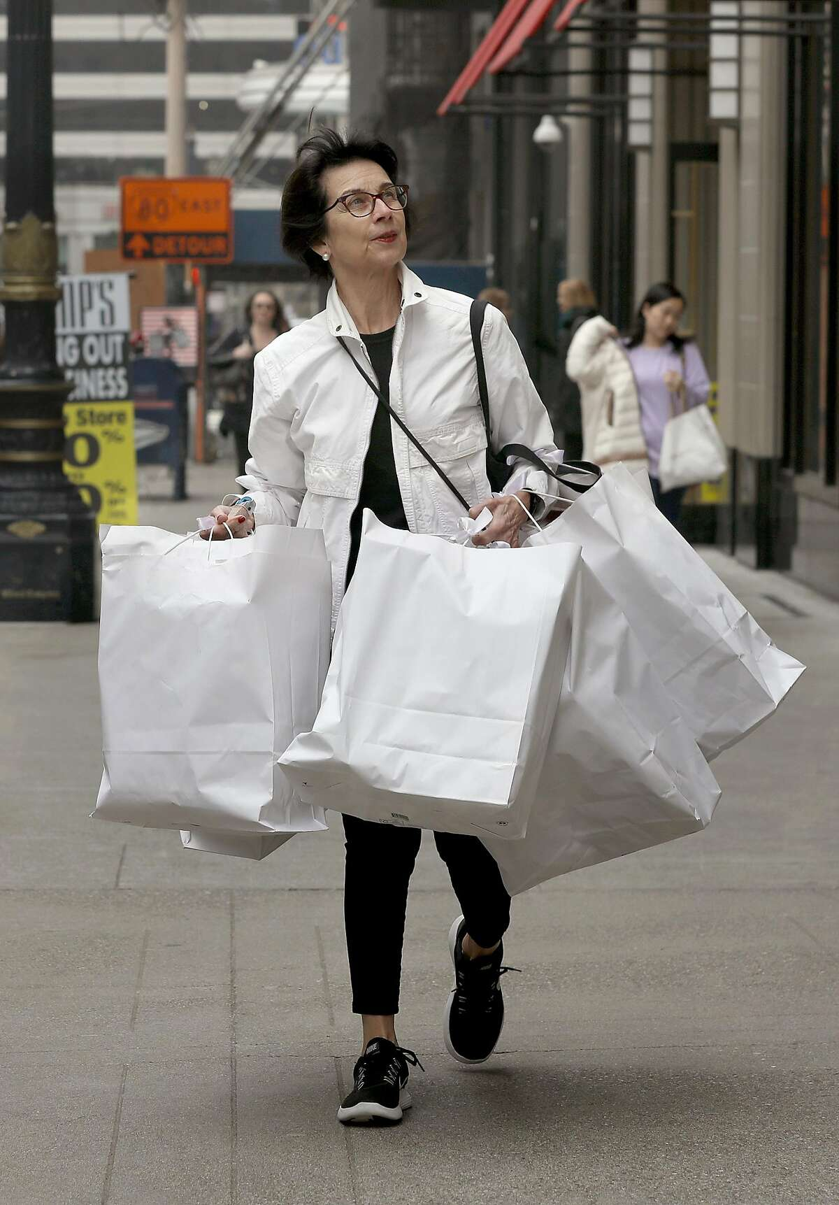 Luxury property specialist Rebecca Hoffman from Compass real estate buys 16 leather wine carriers from Gump's on Thursday, Dec. 20, 2018, in San Francisco, Calif.