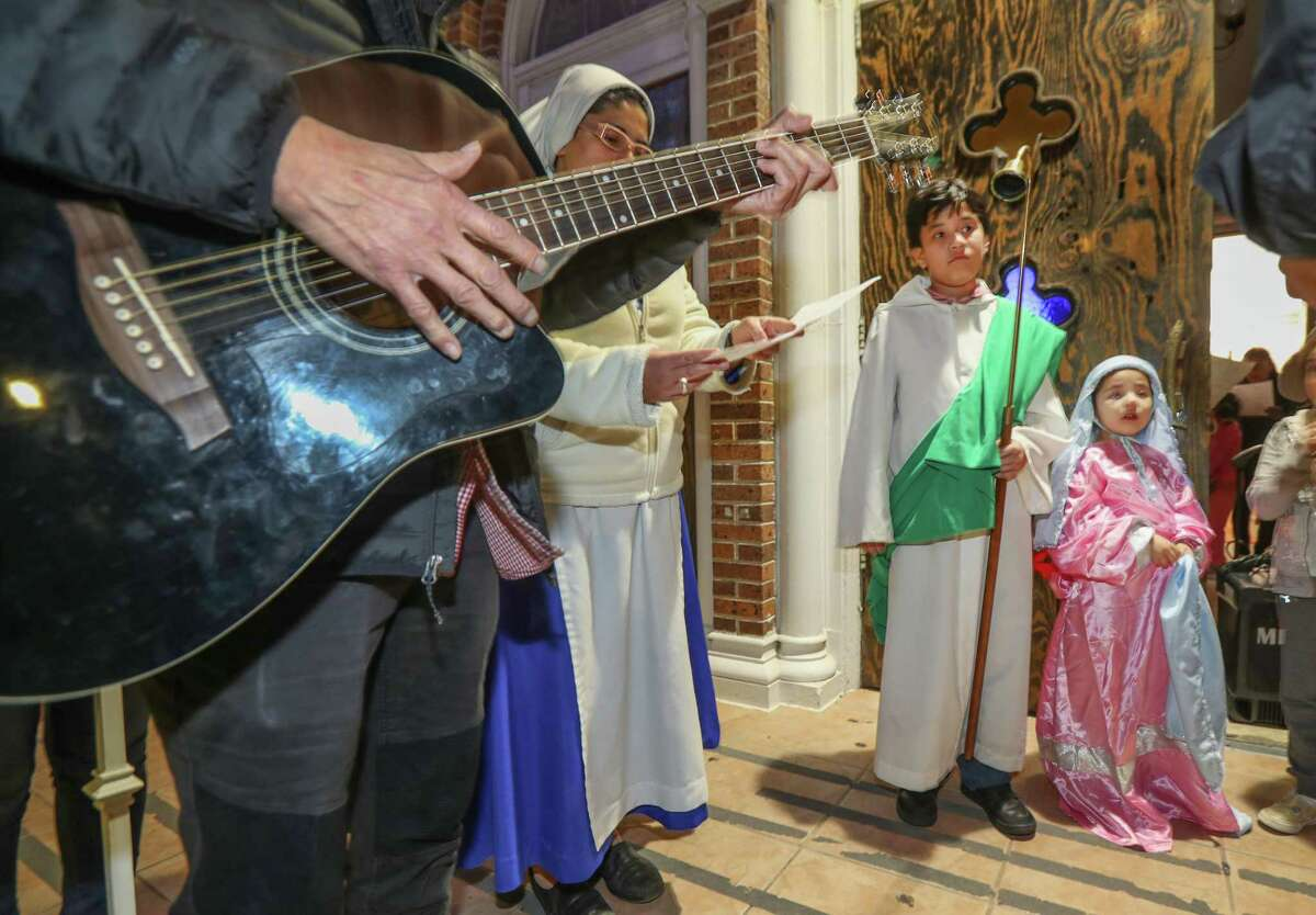Alexander Martinez, 7, and his sister Angela, 4, portrayed Joseph and Mary during the Posadas at the Blessed Sacrament Catholic Church, 4015 Sherman, Thursday, Dec. 20, 2018, in Houston. The re-enacting tradition of posadas, is to honor the journey of Mary and Joseph had as they arrived in Bethlehem to deliver the baby Jesus. The event was hosted by Religious Sisters of the Comunidad Apostólica de María Siempre Virgen.