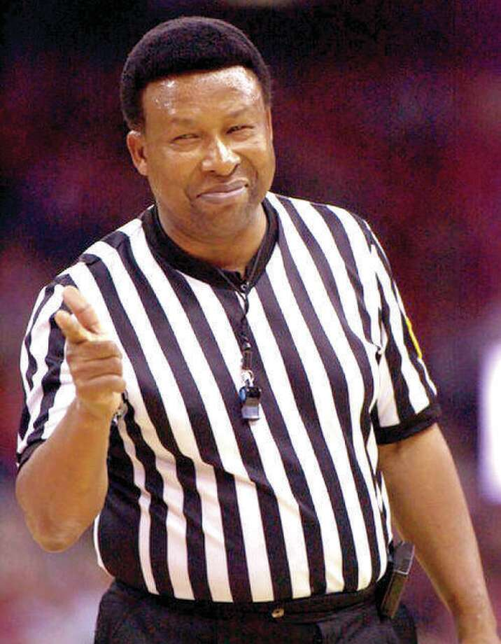 Former Edwardsville District 7 Superintendent Ed Hightower points after calling a foul during his days as one of the top NCAA basketball officials. Photo: Associated Press