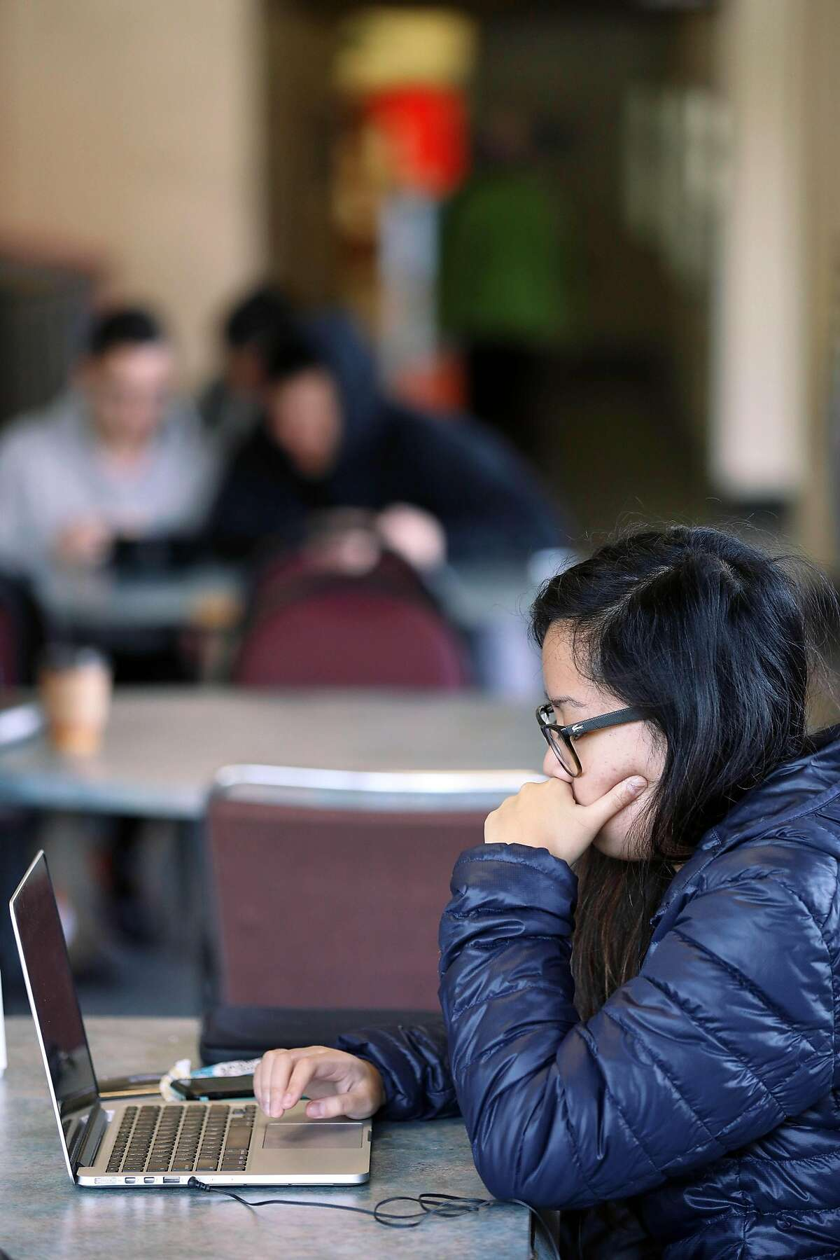 City College student Alexa Bautista works on her laptop in Smith Hall between finals on Tuesday, December 18, 2018 in San Francisco, Calif.