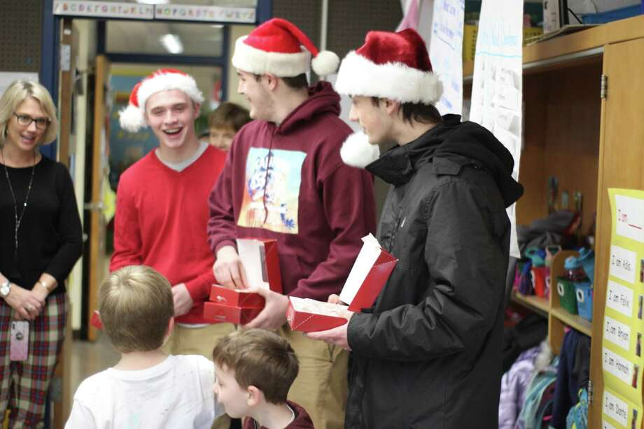 The officers of the Wamogo Class of 2019 Student Council went to Goshen Center School to spread holiday cheer Dec. 20. The seniors, Luke Waldron, Dominic Iannone, Devin Rhoads, and Jackie Weik, along with class advistors Sue Clarkin and Shawn Tobin, and Tracy Keilty, Goshen Center School Principal, visited each classroom and delivered candy canes to the students. This is the second year they have run this event, and it is a highlight of the season for everyone involved, Tobin said. Photo: Jackie Weik / Contributed Photos