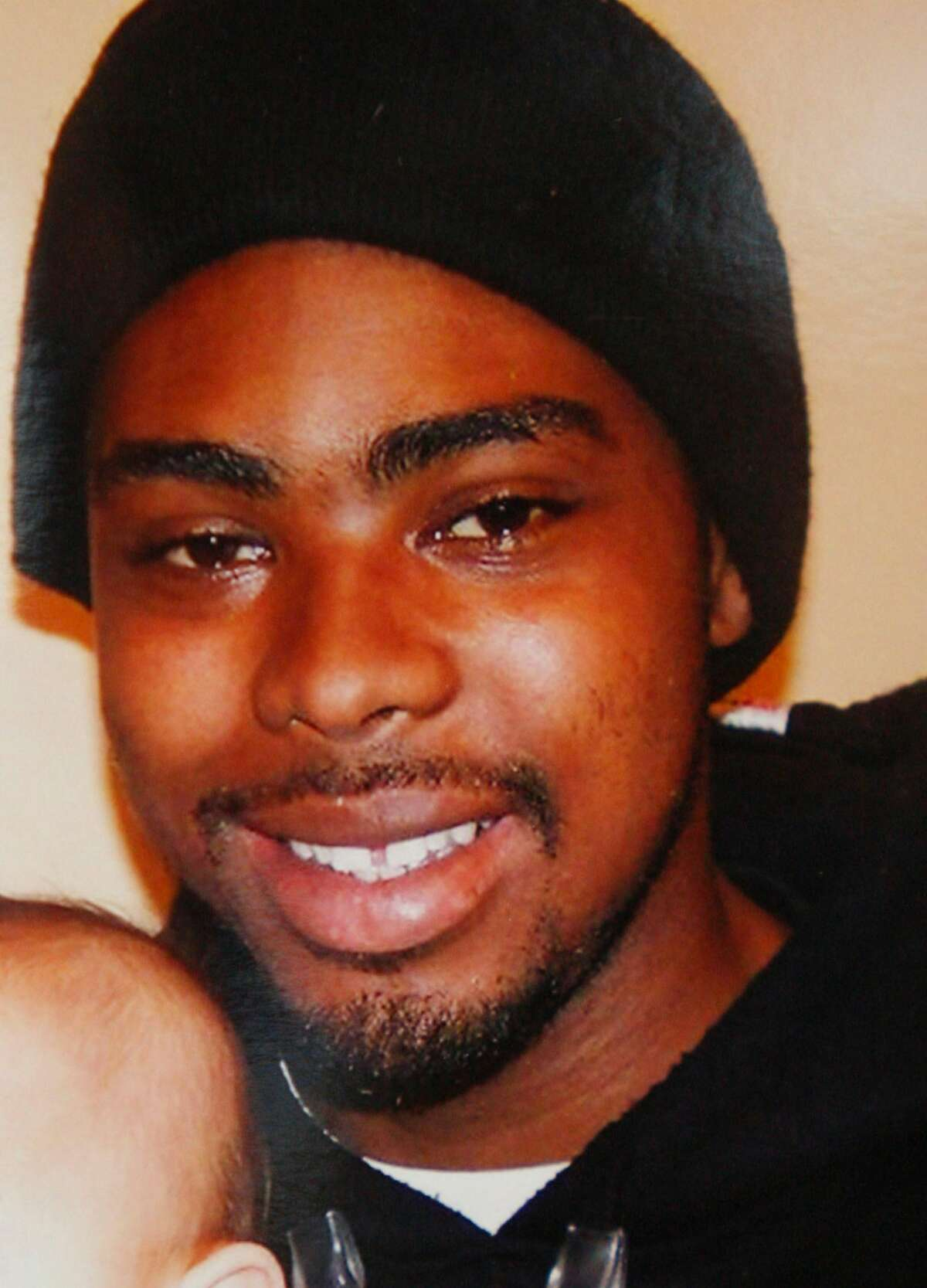 A copy of a portrait of Oscar Grant taken last month was on display as attorney John Burris, representing the family of Oscar Grant, slain by a BART police officer New Year's Day, held a press conference near his office in Oakland, Calif. on January 4, 2009.
