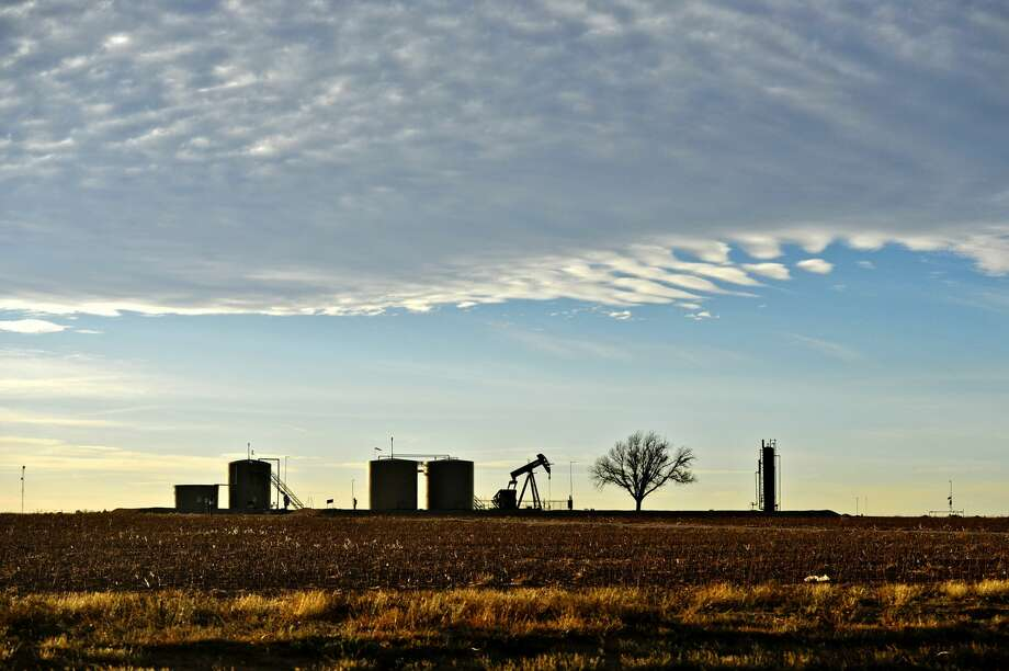 Pumpjack and tank battery operating in Greenwood, Midland County, Texas, Dec. 21, 2018. KEEP GOING to see photos of oil production in the Permian Basin. Photo: James Durbin