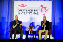 Dow CEO Elect Jim Fitterling, left, and LPGA CCO Jim Podnay talk about the inaugural Dow Great Lakes Bay Invitational during a press conference at the Midland Country Club on May 10, 2018.