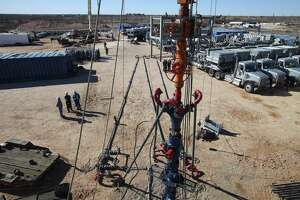A well is drilled at an Apache Energy site in the Permian Basin in Midland.