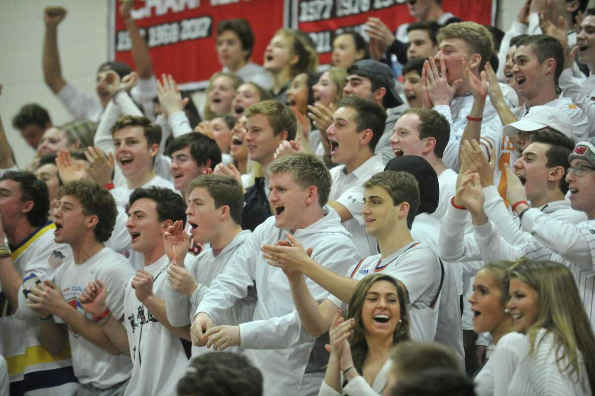 The New Canaan fan section cheers on the Rams during a game against the Greenwich Cardinals on Friday December 21, 2018 at New Canaan High School in New Canaan, Connecticut.