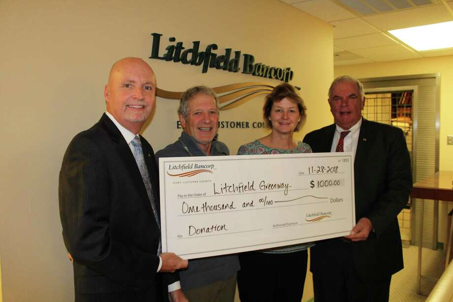 From left, Paul McLaughlin, Clifford Cooper, Berta Andrulis-Mette and Thomas Villanova took part in a donation presentation from Litchfield Bancorp to the Litchfield Community Greenway. Photo: Contributed Photo