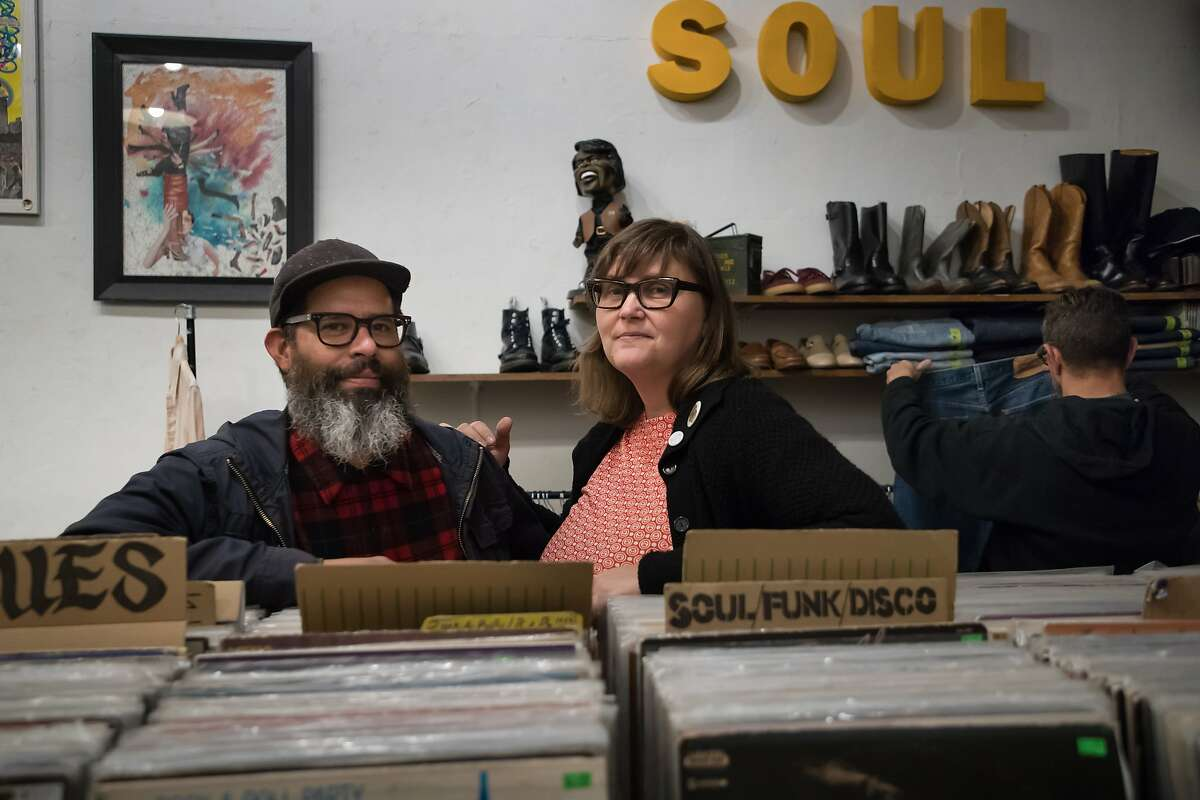 VAMP owners Fernando Carpenter and Tracy Parker pose in their store on Saturday, Dec. 15, 2018, in Oakland, Calif.