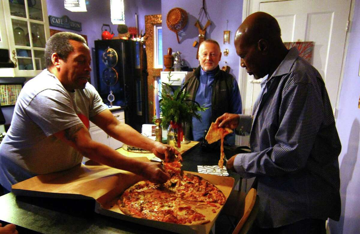 Musician George Baker, right, enjoys some pizza Modern Apizza with his friends Hayward Gatling, left, and Les Ross.