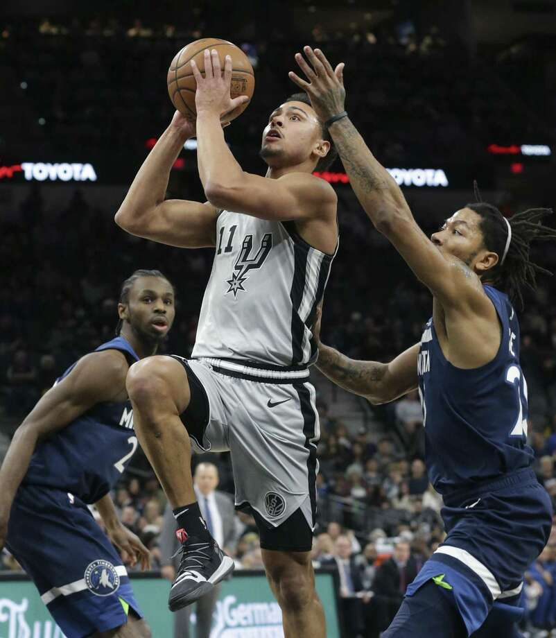 Bryn Forbes slips by Wolves defenders Andrew Wiggins, left, and Derrick Rose to get to the hoop as the Spurs host the Timberwolves at the AT&T Center on December 21, 2018. Photo: Tom Reel, Staff / Staff Photographer / 2017 SAN ANTONIO EXPRESS-NEWS