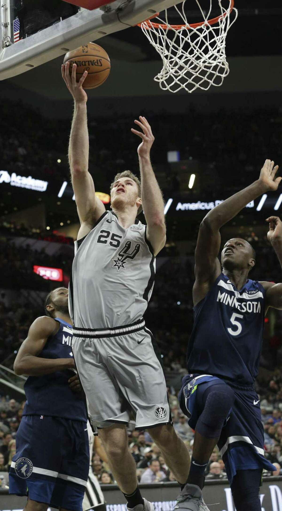 Jakob Poeltl gets a alyup around Gorgui Dieng as the Spurs host the Timberwolves at the AT&T Center on December 21, 2018.