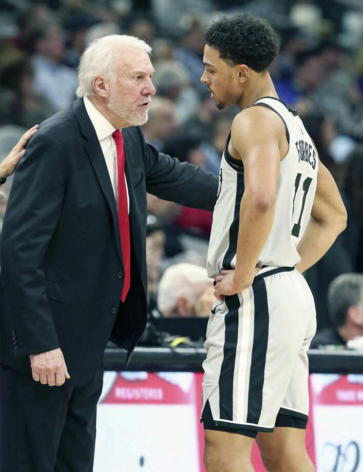 Gregg Popovich has some stern coaching words with Bryn Forbes in the second half despite the guard's game high performance as the Spurs host the Timberwolves at the AT&T Center on December 21, 2018. Photo: Tom Reel,  Staff / Staff Photographer / 2017 SAN ANTONIO EXPRESS-NEWS