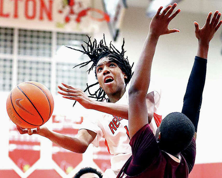 Alton's Donovan Clay scored 24 points, including 18 in the second half, in his team's 53-40 victory over Chatham Glenwood Friday night at Alton High. Clay is shown in action last season against Belleville West. Photo: Billy Hurst File | For The Telegraph