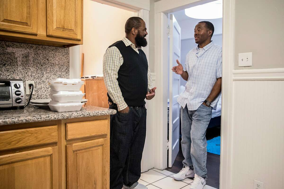 Shadeed Wallace-Stepter (right) and Earlonne Woods, whose sentences were recently commuted allowing their release from San Quentin, chat while standing in Shadeed's new room at Re:Store Justice in Oakland, Calif. Thursday, Dec. 20, 2018.