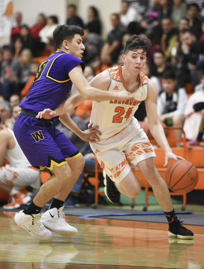 Carlos Guzman had four rebounds, three points and a steal Friday as United opened district play with a 65-47 victory at home over LBJ. Photo: Danny Zaragoza / Laredo Morning Times / Laredo Morning Times