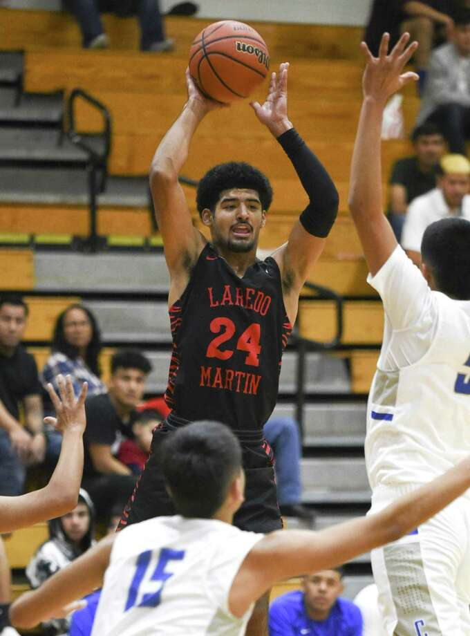 Mathew Duron recorded a triple-double — 11 points, 13 rebounds and 11 assists — in Martin's 84-45 win over Cigarroa. Photo: Danny Zaragoza /Laredo Morning Times / Laredo Morning Times
